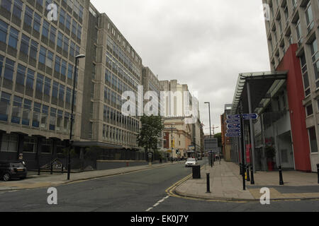 Grey sky view, from Lower Byrom Street to Opera House, 1960s Quay House and Astley House above Quay Street, Manchester, - Stock Photo