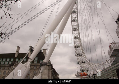 View of the London Eye showing the supporting structure and passenger capsules - Stock Photo