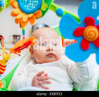 baby clutched colorful toy - Stock Photo