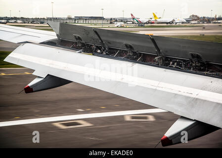 Airplane wing at landing, Heathrow airport, London, England, UK - Stock Photo