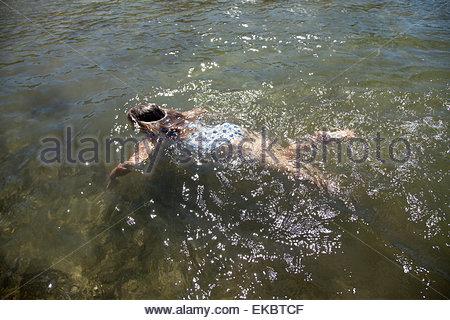 Girl swimming with goggles, Lake Okareka, New Zealand - Stock Photo