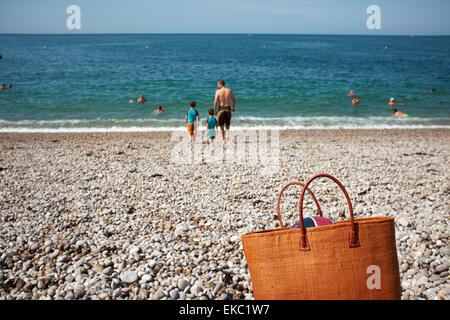 Rear view of father and two sons on beach, Normandy, France - Stock Photo