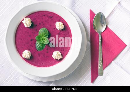 Food on white tablecloth - Stock Photo