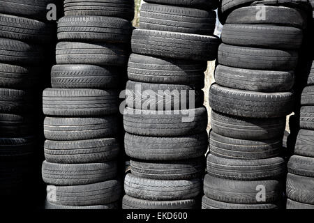 car tires pneus stacked in rows - Stock Photo