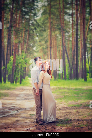 Gentle couple on romantic date, wedding day ceremony in the forest, tender feelings, enjoying spring nature and - Stock Photo