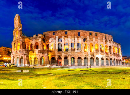 Colosseum, Rome, Italy. Twilight view of Colosseo in Rome, elliptical largest amphitheatre of Roman Empire ancient - Stock Photo