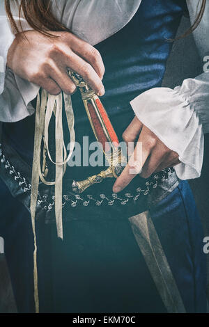 Medieval woman holding a dagger - Stock Photo