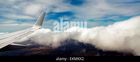 View of airplane wing from inside the airplane cabin. - Stock Photo