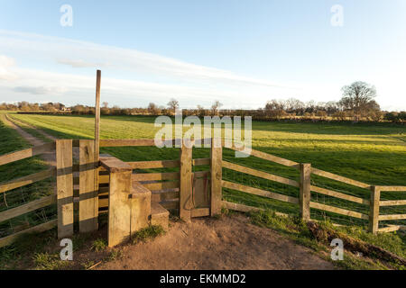 A stile on a countryside walk down the river Ouse in York, North Yorkshire, on a beautiful summer's evening. - Stock Photo
