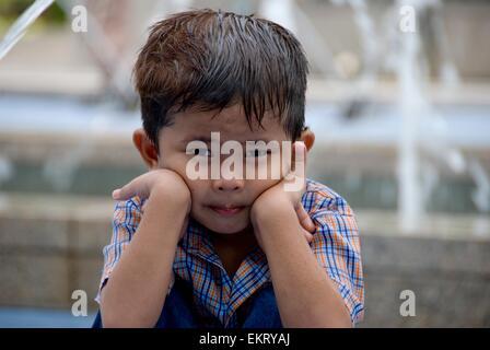 Kuala Lumpur, Malaysia; Portrait Of A Young Boy - Stock Photo
