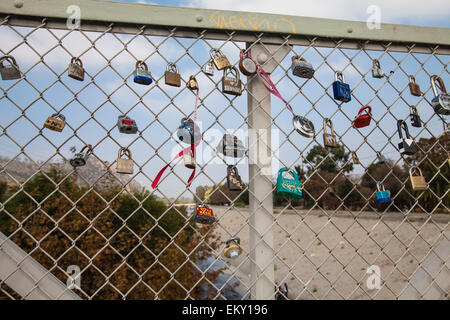 Love Locks adorn the Sunnynook Pedestrian Bridge over the Los Angeles River along the Glendale Narrows - Stock Photo
