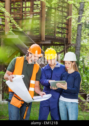 Architects Using Digital Tablet At Construction Site - Stock Photo