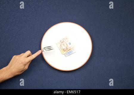 eating euros - Stockfoto