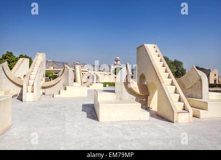 Jantar Mantar observatory complex at blue sky in Jaipur, Rajasthan, India - Stock Photo