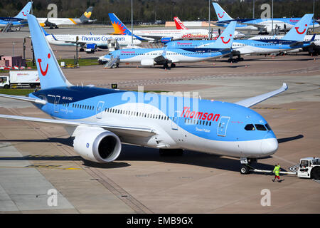 Thomson Airways Boeing 787-8 pushes back from terminal two at Manchester airport. - Stock Photo