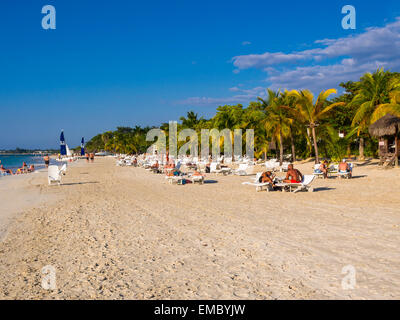 Jamaica, Negril, view to sandy beach with sunbathing tourists - Stock Photo