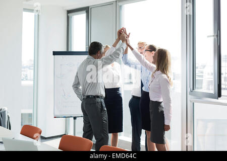 Successful business people raising hands - Stock Photo