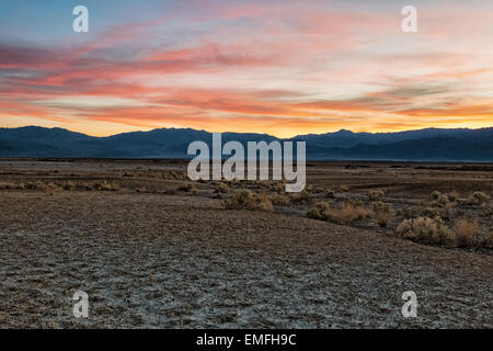 Sunset over the Panamint Mountain Range from Mesquite Flat in California's Death Valley National Park. - Stock Photo