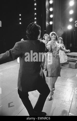Members of the cast of Grease seen here on stage at the Coventry Theatre during a dress rehearsal. The musical show - Stock Photo