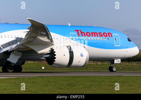 Thomson Airways Boeing 787-8 touches down on runway 05R at Manchester airport. - Stock Photo