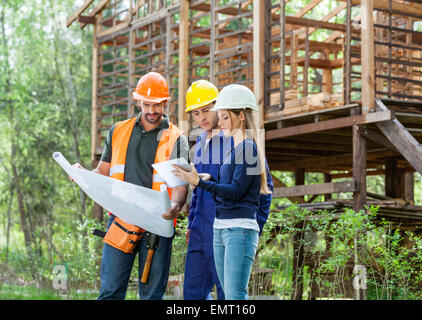 Architects Using Digital Tablet At Site - Stock Photo