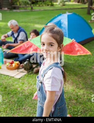 Smiling Girl Standing At Campsite - Stock Photo