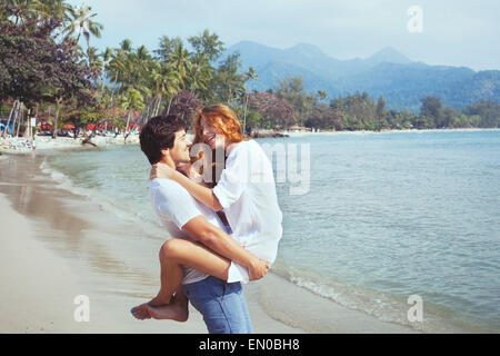 happy young family on the beach, couple during honeymoon - Stock Photo
