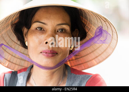 A Vietnamese Woman Wearing Traditional Conical Hat - Stock Photo