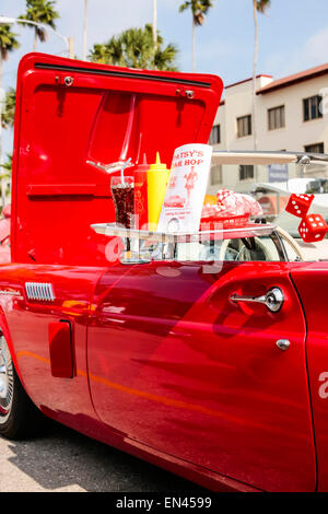 A window tray on a classic american car used for fast food for American cuisine movie online