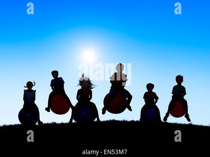 Silhouettes of Children Playing on Balls and Copy Space Above - Stockfoto