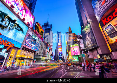New York City, USA in Times Square crowds and traffic at night. - Stock Photo