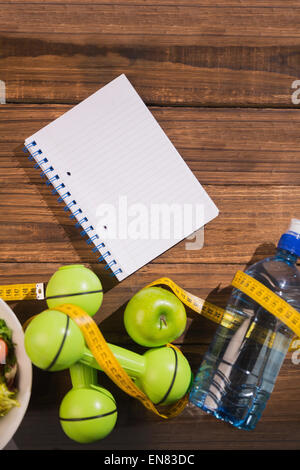 Notepad with indicators of healthy lifestyle - Stock Photo