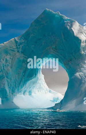 Natural Arch carved in an iceberg, Antarctic Sound, Antarctic Peninsula - Stock Photo