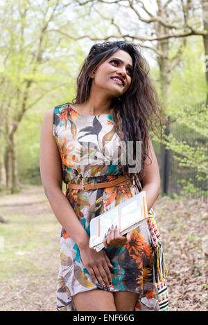 http://n450v.alamy.com/450v/enf66g/young-indian-woman-walking-in-the-forest-with-a-map-enf66g.jpg