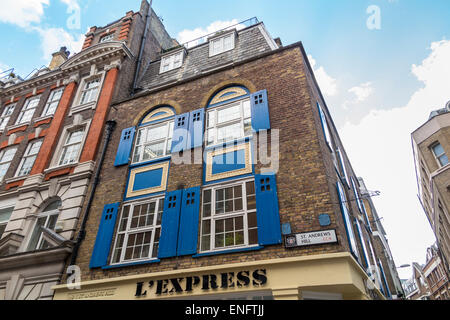 Victorian converted warehouse building with blue window shutters at St Andrews Hill in the City of London EC4, UK - Stock Photo