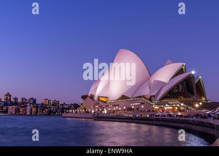 Sydney Opera House in Sydney Harbour, Sydney, New South Wales, Australia at sunset - Stock Photo
