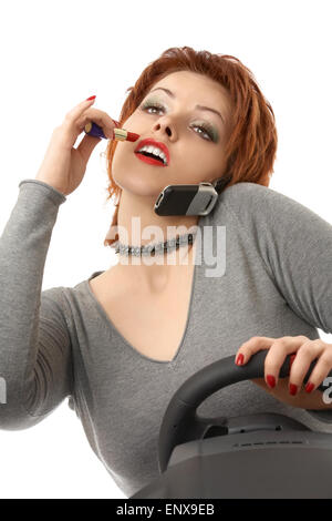 Scene - the woman doing a make-up during driving on the car - Stockfoto
