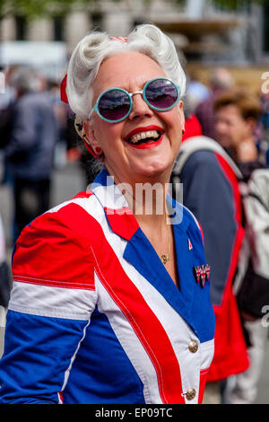 A Woman Dressed In A Union Flag Costume In Trafalgar Square On The 70th Anniversary of VE Day Celebrations, London, - Stock Photo