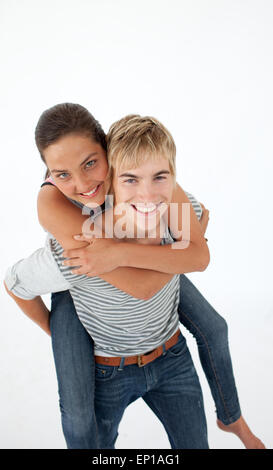 Young boy giving his friend piggyback ride - Stock Photo