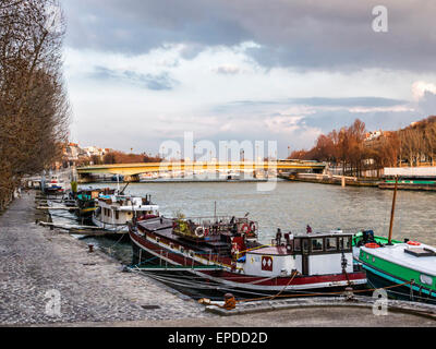 View of Pont de l'Alma bridge, houseboats and river Seine from the Passerelle Debilly footbridge - Stock Photo