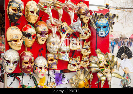Group of famous traditional Vintage venetian carnival masks closeup in a street shop at at Venice, Italy - Stock Photo