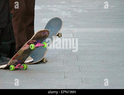 Young teen friends on skateboards skateboard, skateboarder, skateboarding, skating, group, skate, wheel, deck, trainers, - Stock Photo