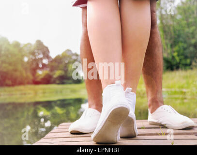 couple kissing on the pier near lake in hot summer day, summer concept - Stock Photo