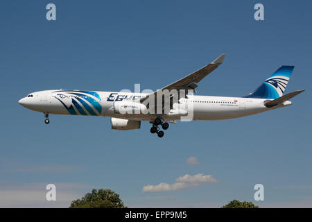 Egyptair Airbus A330-300 on approach to London Heathrow - Stock Photo