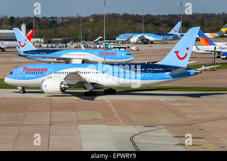 Thomson Airways Boeing 787-8 taxis to runway 05L at Manchester airport. - Stock Photo