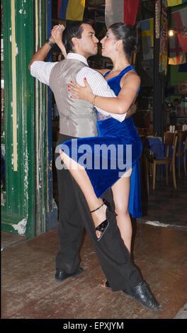 Couple dancing the tango in restaurant La Boca Buenos Aires Argentina - Stock Photo