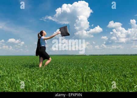 girl in suit walking on a field - Stock Photo