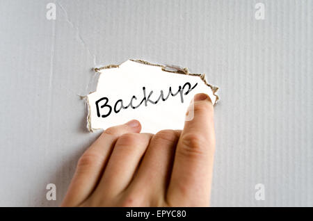 Hand and text on the cardboard background Backup - Stock Photo