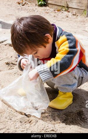 toddler boy child reaching dangerous kitchen cupboards by ...