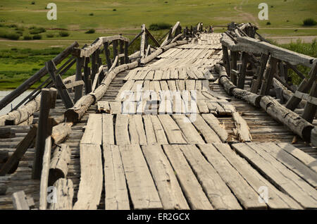 A wooden bridge over the Tamir river in the Arhangay province, Mongolia. - Stock Photo